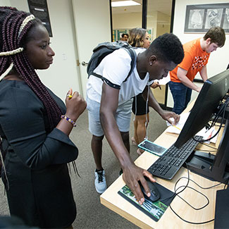 NOVA Students getting help in the financial aid office