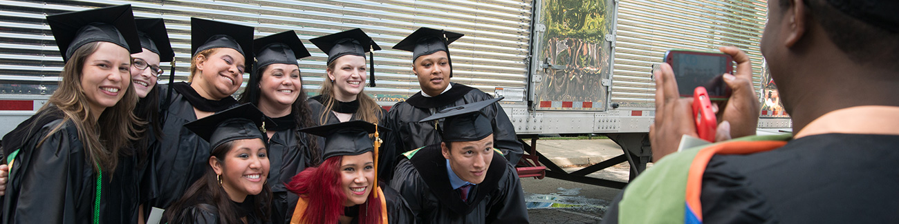 Students posing after Commencement