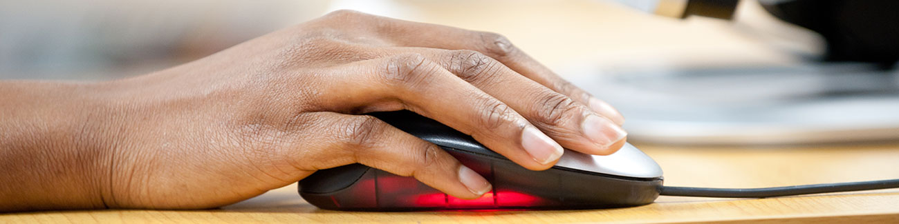 students hand using a computer mouse