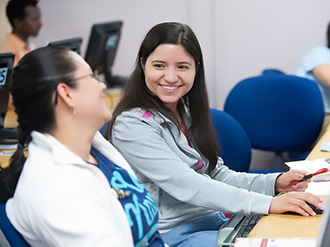 two esl students share a laugh after class