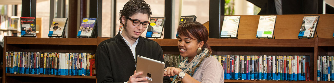 students use an iPad in the library