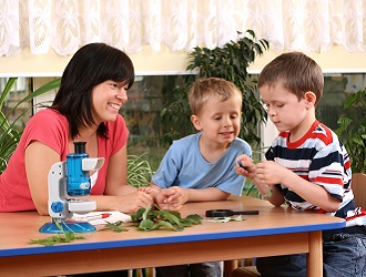 children study with teacher
