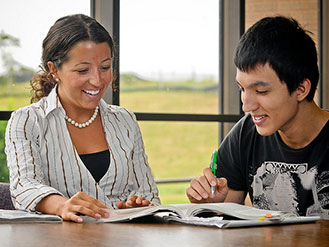 Counselor and student review the schedule of classes